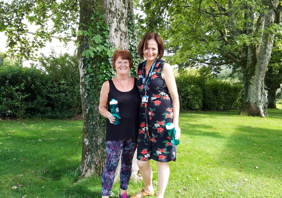 Get active and well, Julie and Sophie standing by the trees at CFT